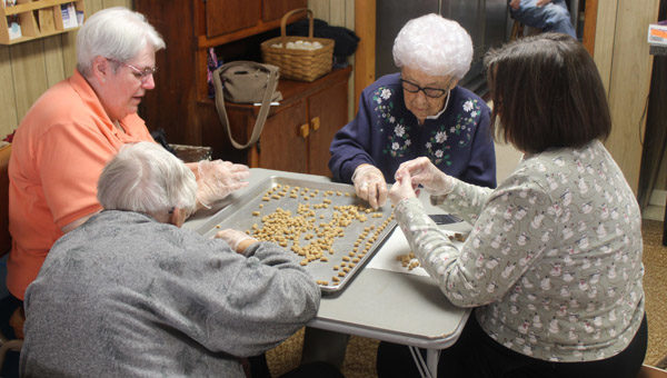 Pam DeFisher, new resident to Peabody, and Sadie Decker and others arrange the peppernuts on the sheet to prepare them for baking. Sadie is 101. Laura Fowler Paulus / Free Press