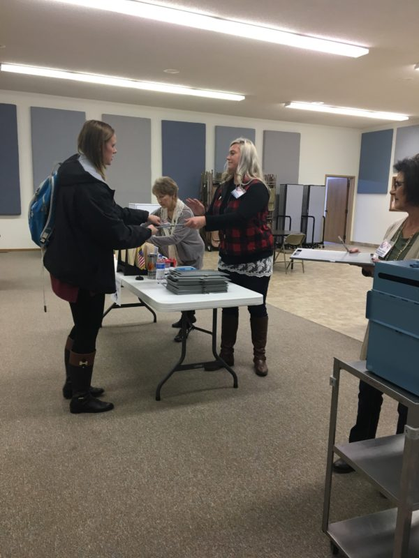 A local Hillsboro resident checks in so that she can cast her ballot.