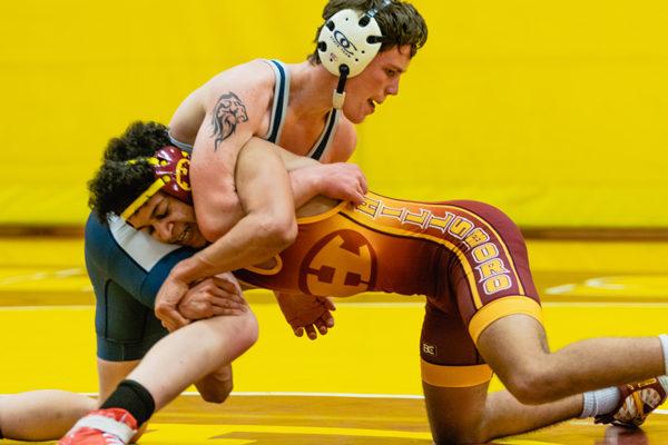 Junior Raymond Johnston weight class 126 (wrestling Dayton Randall from Minneapolis)