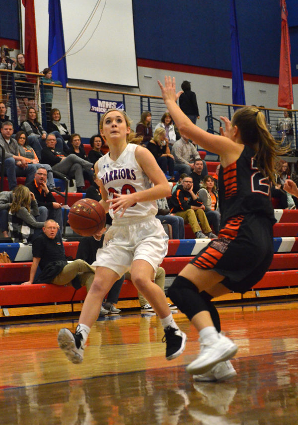 ayden May drives into the lane during the first half with Inman Friday. May scored two points in Marion's 53-27 loss to the second-ranked Teutons. Janae Rempel / Free Press