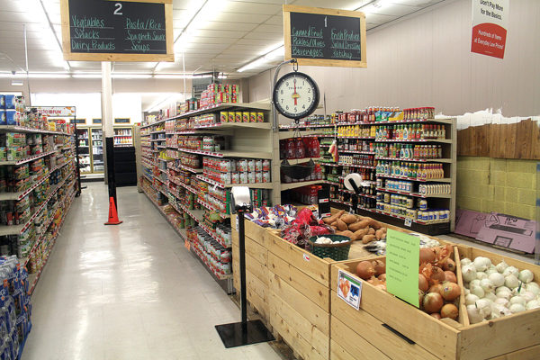 The aisles at Peabody Market are marked with chalkboards hanging above them.
