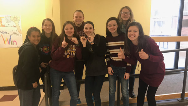 From left: Jerusalem Driggers, Landry Duerksen, Karley Loewen, Bailee Gawith, Makenna Reed, Annaliese Jorgenson, Riley Driggers and Zaylee Werth pose after announcing that they have reached a goal of $1,000. They are some of the Hillsboro Middle School girls who are raising funds to provide wells in Sudan. Laura Fowler Paulus / Free Press