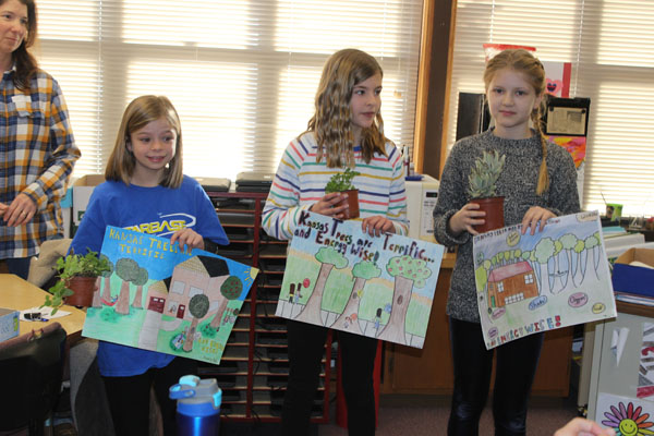 Poster winners receive prizes at HES