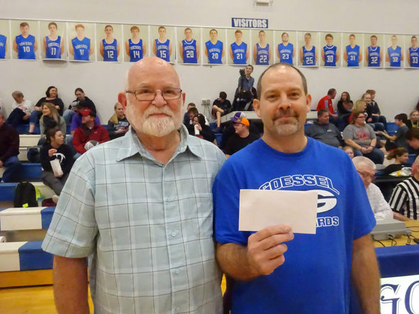 Keith Banman and Stacey Sawyer of Goessel. Sawyer won a gift certificate after winning a musical chair event on Friday.