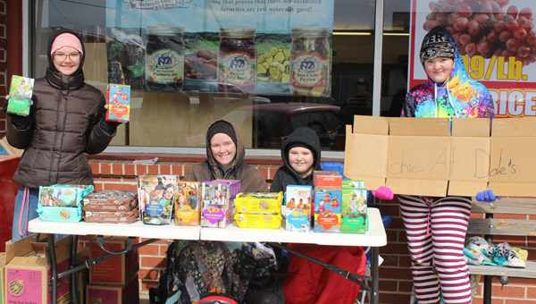 Always be closing- Girl Scout Troop bear the cold to sell cookies.