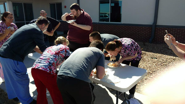 Hospital employees participate in pie eating contest