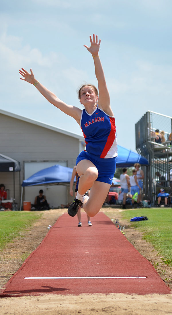 Emmy Hess shows the form that led to a state-qualifying fourth-place finish in the long jump with a personal-best leap of 16-3 ½. Janae Rempel/Free Press