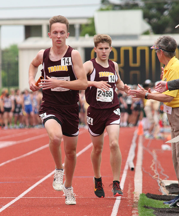 Dillon Boldt handed off the baton to fellow sophomore Caleb Diener during the boys 4 x 800M relay on Saturday.