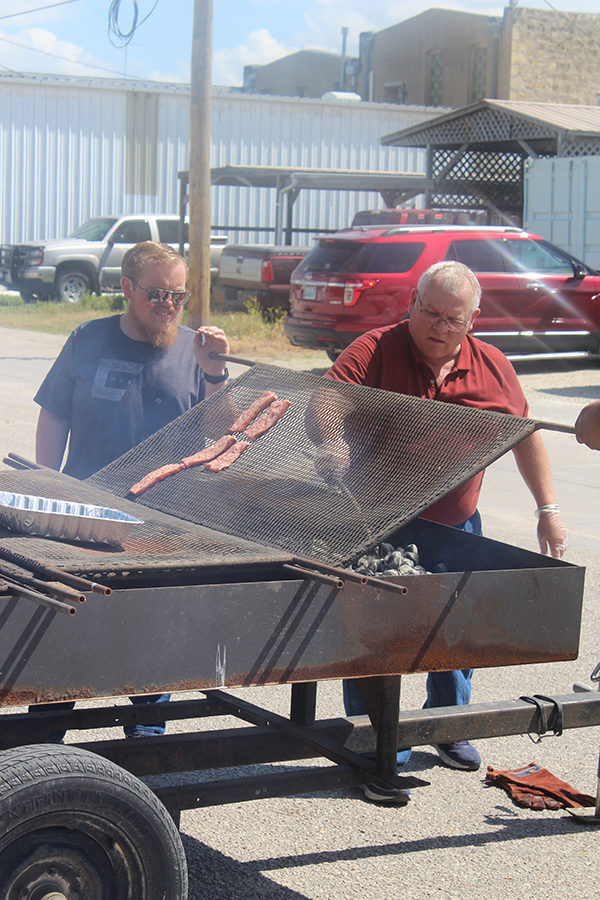 From left, Darren Franz and dad Dale grilled hot dogs and Dale's Sausage for the community event they hosted on Friday to celebrate the store's 60 years. Laura Fowler Paulus/Free Press