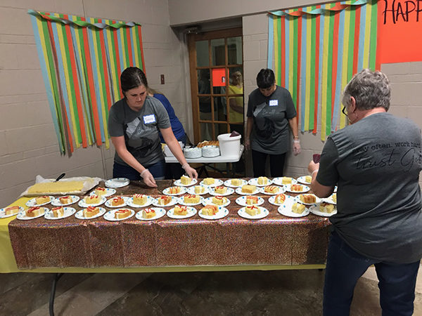 Volunteers helped serve cake at the fundraiser and birthday celebration for Eric Bartel. Laura Fowler Paulus / Free Press