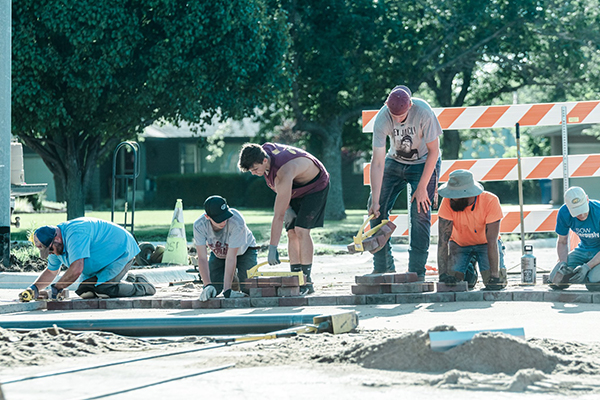 30-40 volunteers showed up several times to help the City of Hillsboro relay the historic bricks on the newly paved roads. City Administrator praised them at the city council meeting last week. Karrie Rathbone / Special to the Free Press