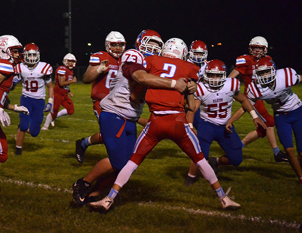 Cade Alleven tackles Celtic ball-carrier Lucas Hammeke after a third-quarter interception Friday. Hutchinson Trinity defeated Marion, 14-8, in the Warriors' season-opener. Janae Rempel / Free Press