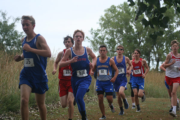 Marion freshmen Tristen Dye leads the Warrior boys at the Halstead Invitational on Thursday. Bill Bush / Free Press