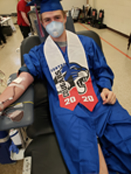 Local student gives back to community in cap, gown