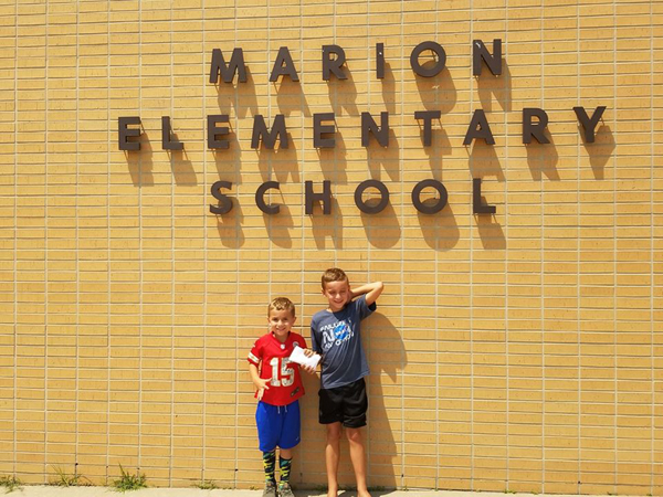 Marion students give money raised to their school