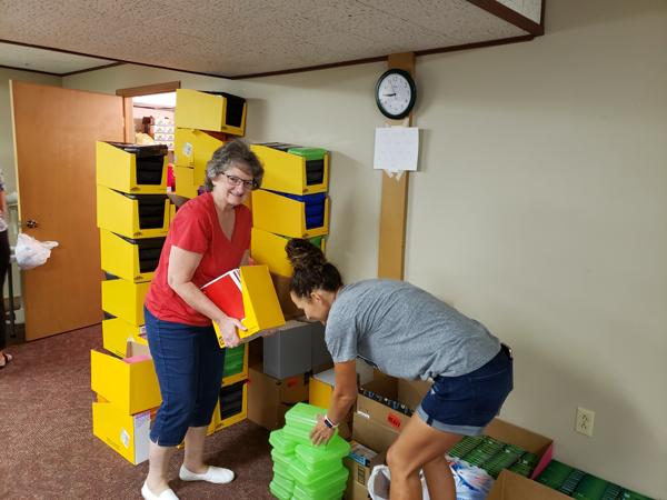 Volunteers help with school supplies
